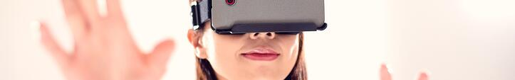 Young Woman Wearing VR Headset Experiencing Augmented Reality Video