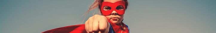 Young Kid in Superhero Outfit Punching at the Camera Crushing It